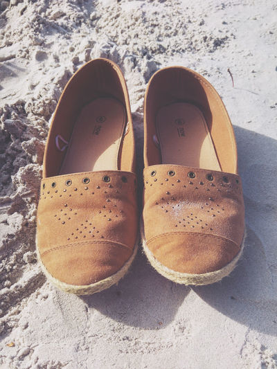 High angle view of brown shoes at beach