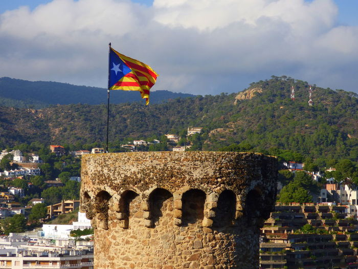 Architecture Built Structure Costa Brava Tossa De Mar Day Flag Independence Catalan Flag In One Of The Towers Of The Enclosure Amaurallado Of Tossa De Mar Nature No People Outdoors Patriotism Sky Tree