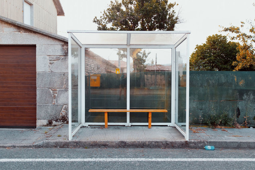 LOST IN GALICIA 🚌 Lostingalicia Threeweeksgalicia Bus Stop Tree Day Plant No People Nature Outdoors Street Building Exterior Built Structure Architecture Building House Glass - Material Residential District Window Entrance Reflection City Footpath Door