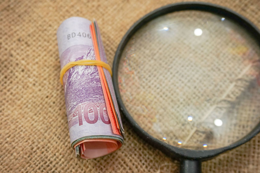 Magnifying glass with Ringgit Malaysia banknotes or money isolated on textured sack background. Business Financial District  Isolated Sale Textured  Bank Close-up Day Finance Indoors  Indoors  Magnifying Glass Money No People Profit Ringgit Savings Text