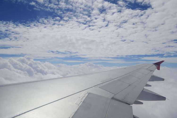 Aerial View Air Vehicle Aircraft Wing Airplane Backgrounds Beauty In Nature Blue Cloud Cloud - Sky Cloudscape Cropped Flying Journey Majestic Mid-air Mode Of Transport Motion On The Move Part Of Scenics Sky The Natural World Transportation Travel White