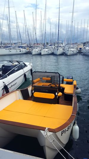 Vertical Moored Nautical Vessel Water Lake Outdoors No People Sky Harbor Sailboat Day Nature Beach Pedal Boat Yacht Mode Of Transport Transportation Catamaran