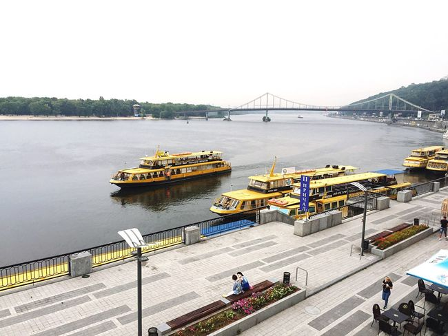 Water Connection Transportation River Bridge - Man Made Structure Travel Destinations Bridge High Angle View Mode Of Transport Engineering Journey Nautical Vessel Outdoors Promenade Day Yellow Kyiv