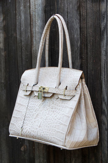 Close-up of purse hanging on wood