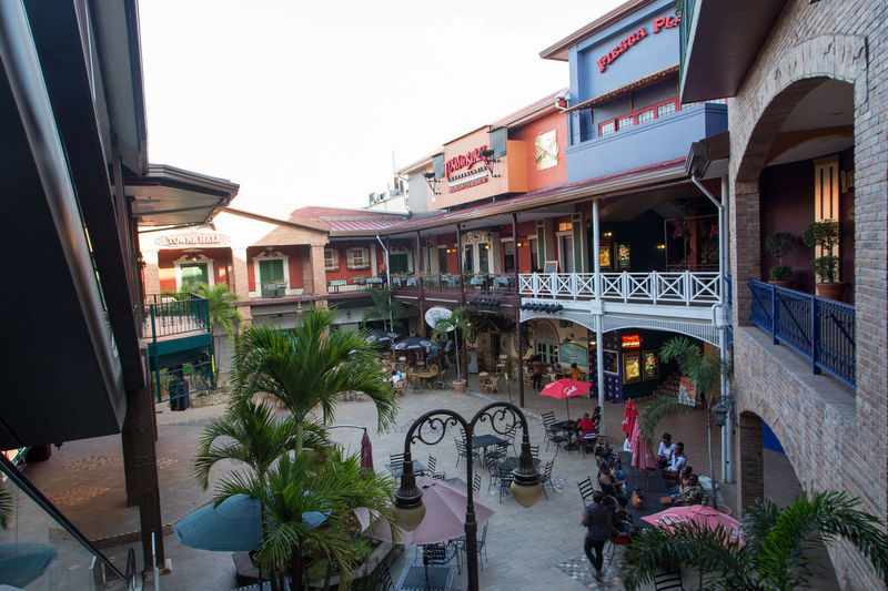 Patio Port Of Spain , Trinidad Capital View Trinidad And Tobago Architecture Awning Building Exterior Built Structure Cafe City Day Incidental People Large Group Of People Men Outdoors People Plant Port Of Spain Port Of Spain Trinidad Real People Sky Store Tree Women