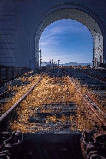 Arch Architecture Nature Sky Rail Transportation No People Built Structure Day Transportation Sunlight Outdoors Metal Track Railroad Track Mode Of Transportation Direction Train Travel Tunnel