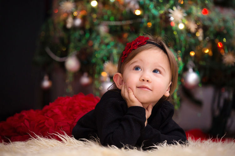 Baby Girl by the Christmas Tree Baby Girl Child Childhood Toddler  Christmas Season  Festivity Winter christmas tree Waiting Anticipation Lights Curious