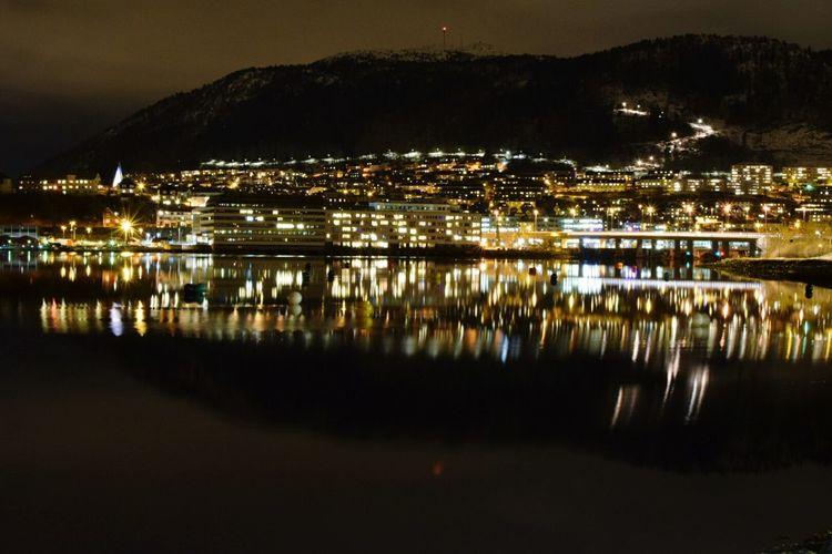 View of illuminated lake at night