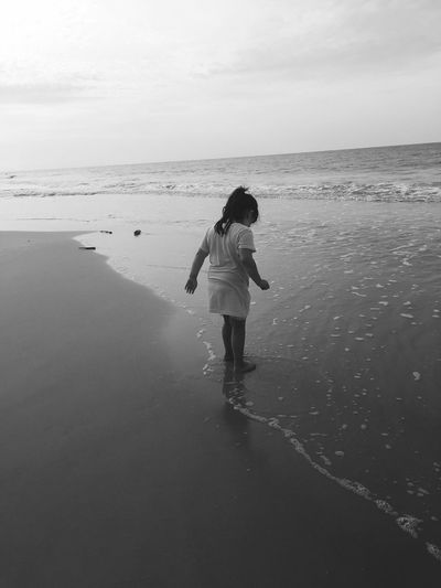 Monochrome Black And White Gulf Shores Travel Destinations Vacation Summer Beach Ocean Child Sea Water Beach Horizon Over Water One Person Sand Nature Beauty In Nature Tranquil Scene Real People Tranquility Standing Scenics Outdoors Day Leisure Activity Sky Full Length Lifestyles Summer Exploratorium