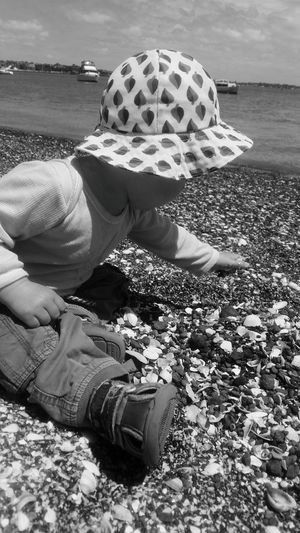 One Person Water Sea Beach Day People Outdoors Relaxation Men Sand Nature Low Section Close-up Sky Blackandwhite Photography Black And White PhonePhotography Childhood Kids Playing Out&bout Beach