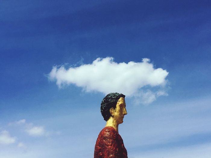 Clouds on your head Cloud - Sky Sky Real People One Person Day Lifestyles Leisure Activity Standing Outdoors Low Angle View Blue Statue Women Nature Young Women Beauty In Nature Young Adult People IPhoneography AtelierArgos
