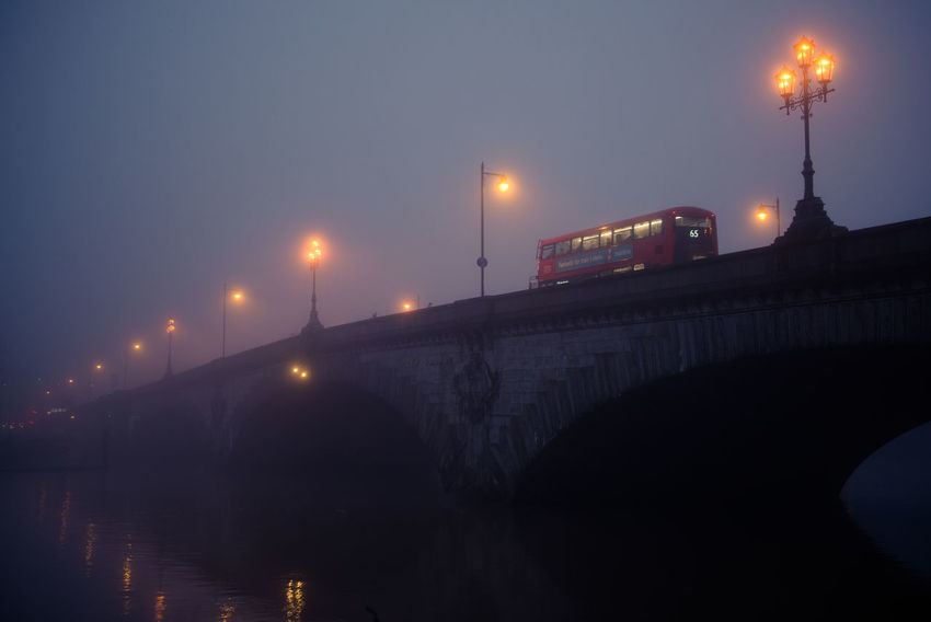 Bridge Bridge - Man Made Structure Fog Foggy Day Foggy Evening Gloomy Gloomy Weather Illuminated Kew Bridge London Outdoors Reflection River Street Light Thames Thames River Water Double Decker Bus Double Decker Red Bus