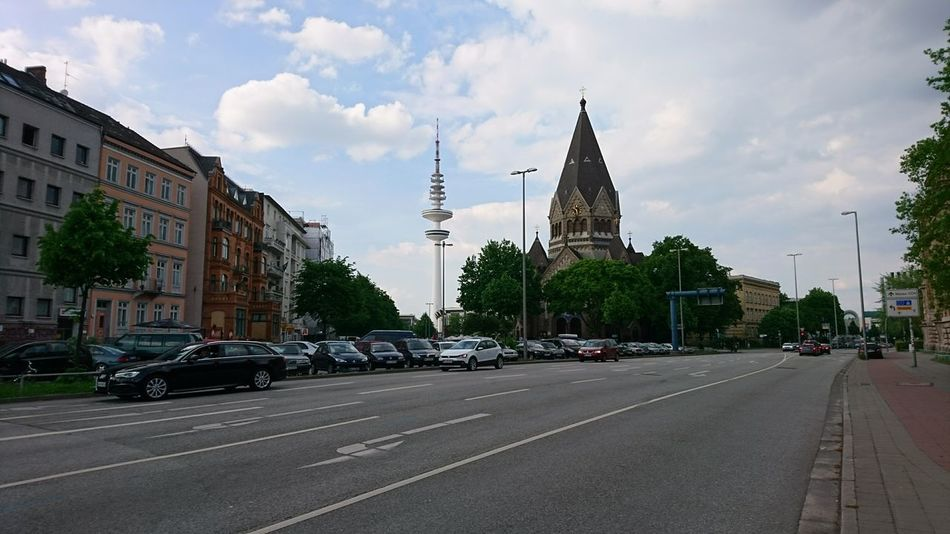 "Heinrich Hertz tower and ""russische orthodoxe Kirche des Heiligen Johannes von Kronstadt."" 😬 · Hamburg Germany Hh 040 Heinrich-Hertz-Turm Messeturm Radio Tower Kirche Church Johannes Von Kronstadt Street View Street Scene Cityscape Architecture Urban Landscape Beautiful Day"