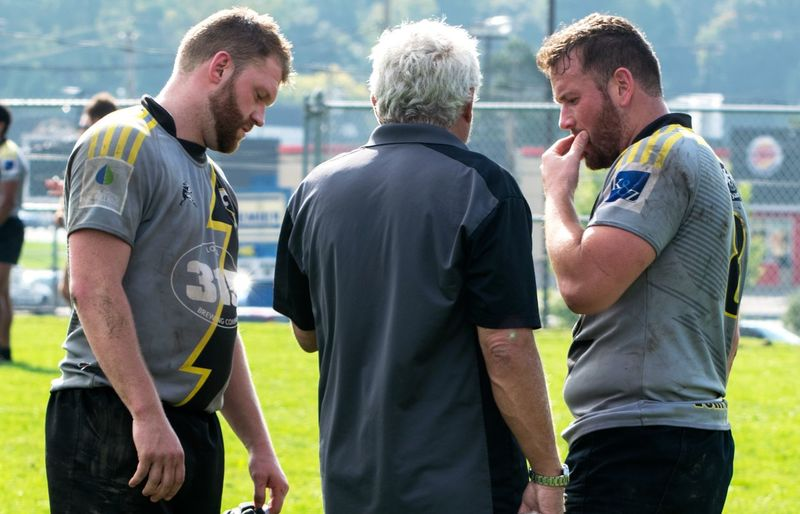 Rugby Players and Coach Men Consulting Planning Something Beard Coach Team Football Athlete Reflective Clothing Teamwork Sportsman Men Sports Clothing Playing Field Sport Standing Rugby