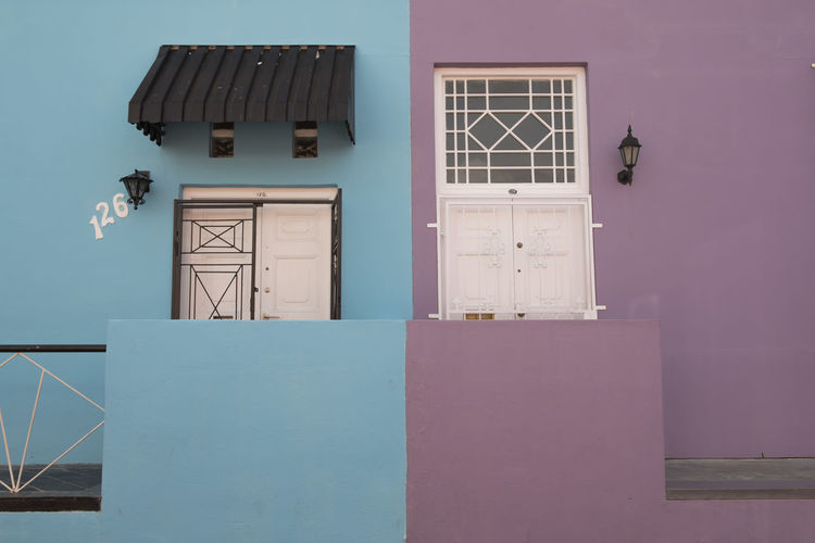 Traveling through South Africa Architecture Blue Bo-kaap Building Exterior Built Structure Capetown City Colors Day Door Doors EyeEm Best Shots Outdoors Railing South Africa Traveling White Window Battle Of The Cities