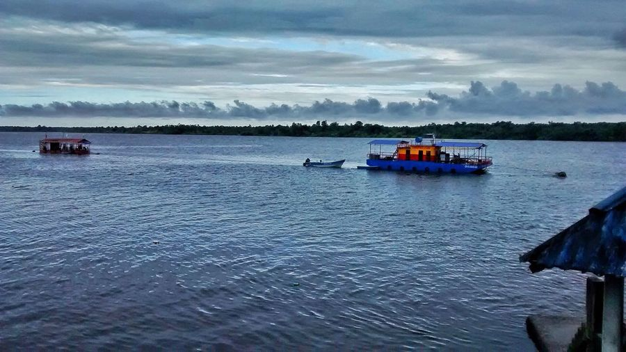 Amazonas. Colombia 🇨🇴 Cloud - Sky Water Nautical Vessel Sky Scenics Nature Transportation Beauty In Nature Tranquility Mode Of Transport Sea Tranquil Scene Waterfront Rippled Day Outdoors Sailing Sitting Horizon Over Water No People