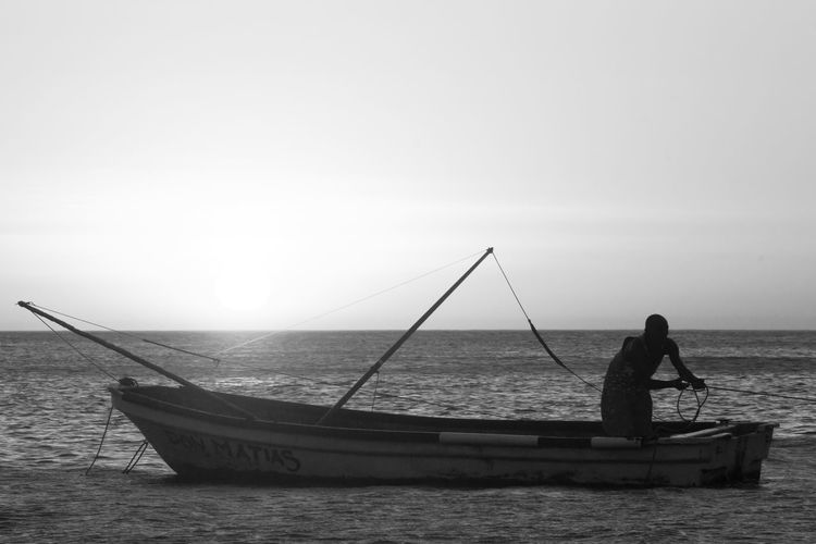 Don Matías Bnw_collection Bnw_life Bnw_society Clear Sky Colombia Colombia ♥  Day EyeEm Best Shots EyeEm Best Shots - Black + White Fisherman Fishing Full Length Gondola - Traditional Boat Holding Horizon Over Water Nautical Vessel One Person Outdoors People Real People Santa Marta, Colombia Sea Sky Standing Water