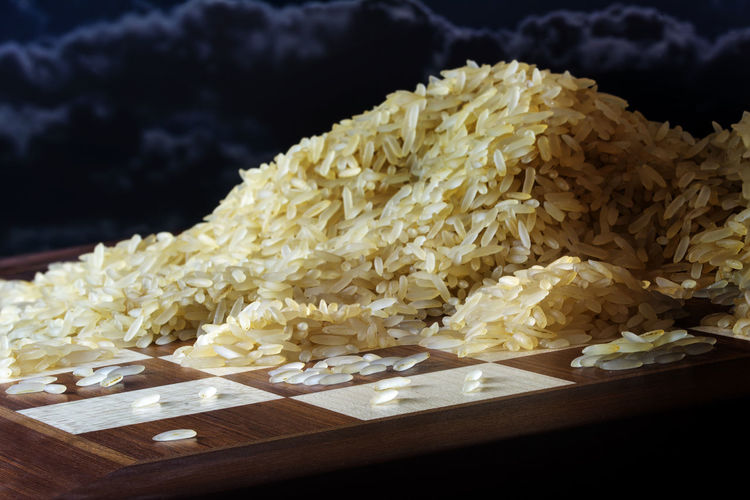 Close-Up Of Raw Rice On Chess Board