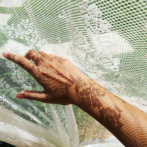 Suntan hand with the light and shadow of lace curtain. Bohemian Day Hand Hippie Holiday Human Body Part Human Hand Indoors  Lace Lifestyles Light And Shadow Real People Tanning White