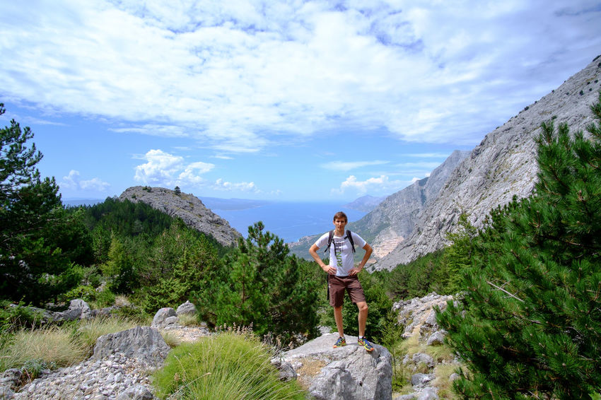 Croatia Backpack Beauty In Nature Biokovo Brela  Casual Clothing Cloud - Sky Day Full Length Landscape Leisure Activity Lifestyles Mountain Nature One Person Outdoors People Real People Rock - Object Scenics Sky Standing Tree Young Adult Young Women
