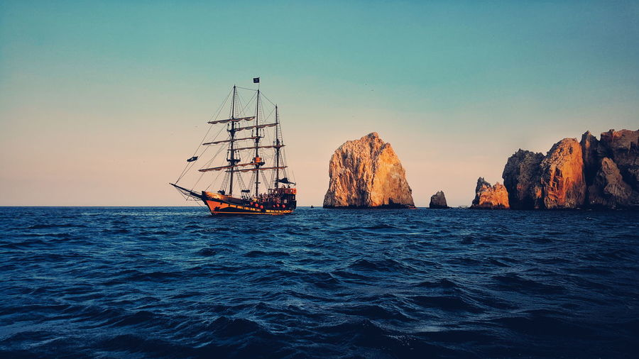 Beauty In Nature Blue Calm Clear Sky Distant Journey Mode Of Transport Nature Nautical Vessel Ocean Pirate Pirate Ship Rippled Sail Sail Boat Sailboat Scenics Sea Seascape Ship Tranquil Scene Tranquility Transportation Water Waterfront Lost In The Landscape