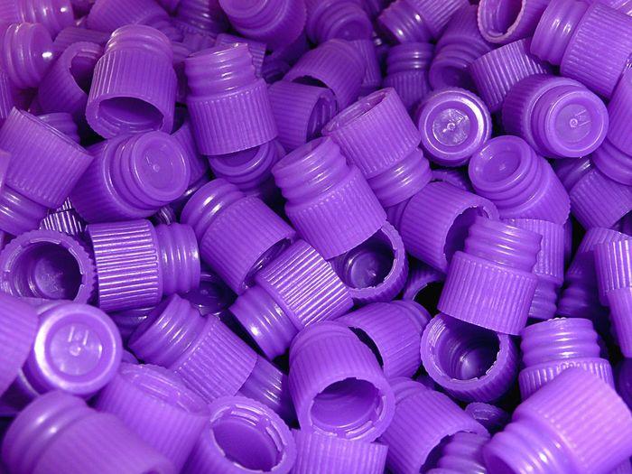Full Frame Shot Of Purple Test Tube Lids