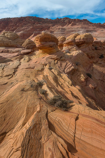 Arizona Formation Formation Flying Hiking Jurassic The Wave Arid Climate Beauty In Nature Climate Day Desert Environment Eroded Erosion Formation Geology Hidden Land Landscape Nature No People Non-urban Scene Outdoors Physical Geography Rock Rock - Object Rock Formation Sand Stone Scenics - Nature Sky Solid Tranquil Scene Tranquility Travel Destinations