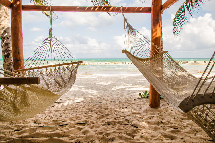Two hammocks dangling in the wind on a nice sunny beach #hammock #lazy #lazyday #view Beach Beauty In Nature Cloud - Sky Day Horizon Over Water Nature No People Outdoors Sand Scenics Sea Sky Tranquil Scene Travel Destinations Water Sommergefühle