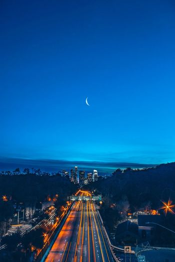 Los Angeles Moon Illuminated Transportation Night Moon Light Trail Clear Sky Blue Mode Of Transport Motion No People Road Outdoors Nature Sky Architecture Astronomy City California Dreamin