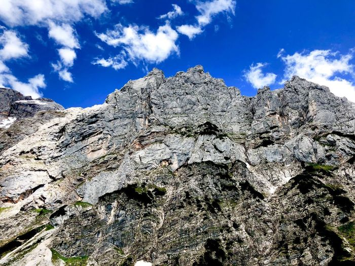 On the way to Dachstein... Austria Alps Dachstein Mountain Rock Sky Cloud - Sky Low Angle View Nature No People Day Plant Beauty In Nature Blue Scenics - Nature Growth Outdoors Land Non-urban Scene The Great Outdoors - 2018 EyeEm Awards