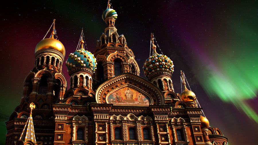 Church of the Savior on Spilled Blood under thye Aurora Borealis - Saint Petersburg, Russia The Church of the Savior on Spilled Blood (Russian: Церковь Спаса на Крови, Tserkovʹ Spasa na Krovi) is one of the main sights of Saint Petersburg, Russia. Other names include the Church on Spilled Blood (Russian: Церковь на Крови, Tserkov' na Krovi), the Temple of the Savior on Spilled Blood (Russian: Храм Спаса на Крови, Khram Spasa na Krovi), and the Cathedral of the Resurrection of Christ (Russian: Собор Воскресения Христова, Sobor Voskreseniya Khristova). This church was built on the site where Emperor Alexander II was fatally wounded by political nihilists in March 1881. The church was built between 1883 and 1907. The construction was funded by the imperial family.[ Saint Petersburg Northern Lights A Taste Of Saint Petersburg Aurora Borealis Aurora In Russia Church Of The Savior On Spilled Blood Northern Lights Architecture Building Exterior Built Structure Dome Illuminated Low Angle View Night No People Outdoors Place Of Worship Religion Sculpture Sky Spirituality Statue Travel Destinations Colour Your Horizn Colour Your Horizn Stories From The City Summer Exploratorium HUAWEI Photo Award: After Dark My Best Travel Photo