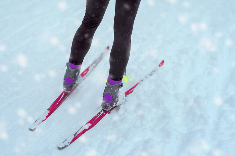 Legs with skis close-up on snow, winter day. Cross country ski. Concept of healthy active lifestyle, winter sport. Abstract season background Low Section Human Leg Cold Temperature Winter Snow One Person Body Part Human Body Part Real People Winter Sport Leisure Activity Lifestyles Ice Day Sport Nature Shoe Unrecognizable Person Warm Clothing Outdoors Human Foot Legs Ski Winter Healthy Lifestyle