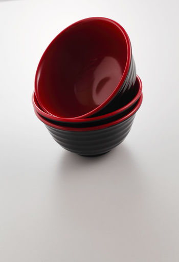 High angle view of red cup on white background