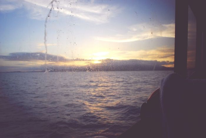 Just a boat ride away: paikura© The Explorer - 2014 EyeEm Awards Sunset Silhouettes Eye4photography  AMPt Community Traveling Home For The Holidays On A Boat Sea Travel Sunset