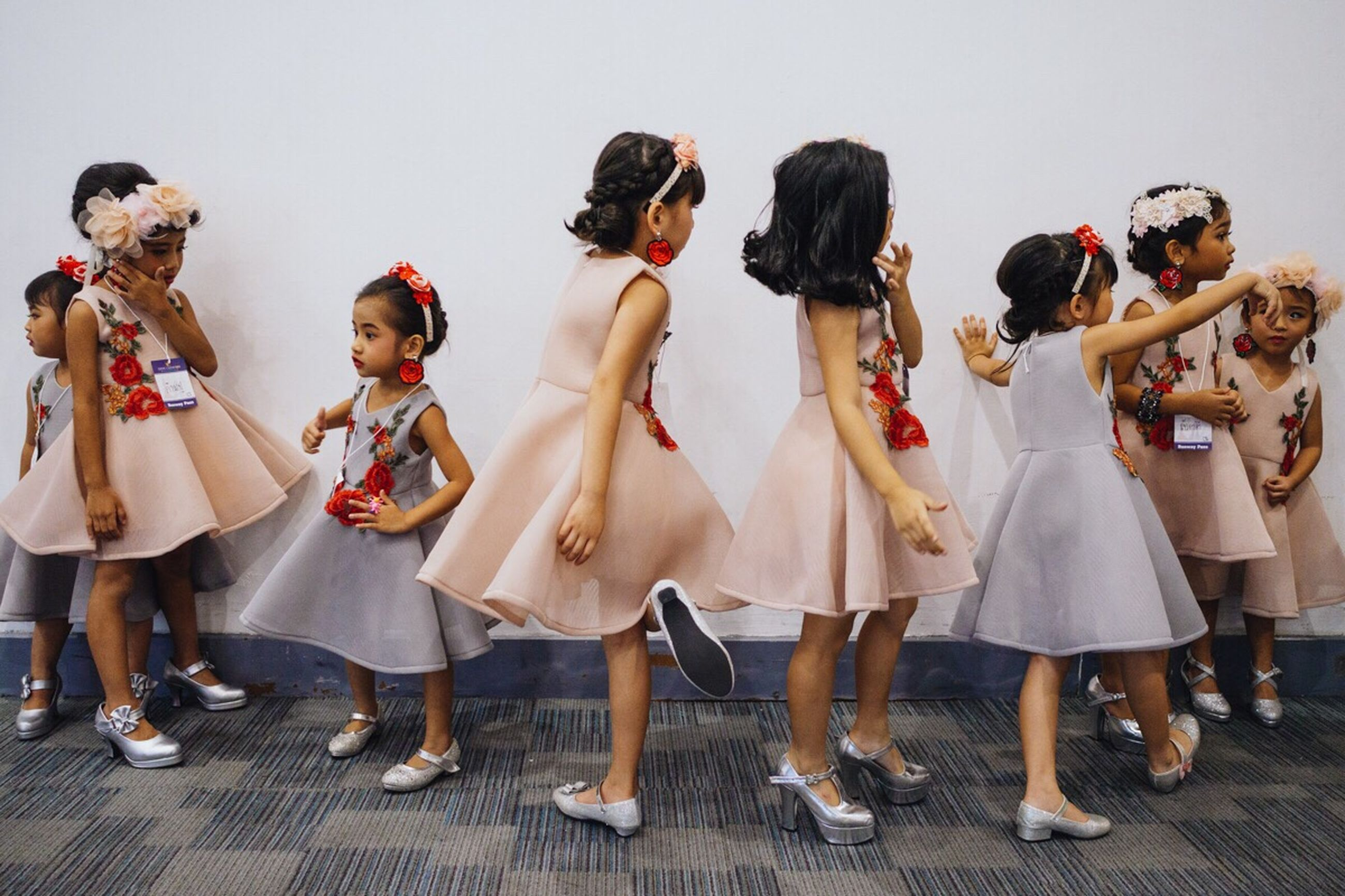 group of people, women, fashion, child, females, clothing, girls, people, dress, full length, real people, celebration, togetherness, childhood, adult, standing, lifestyles, leisure activity, dancing, bridesmaid