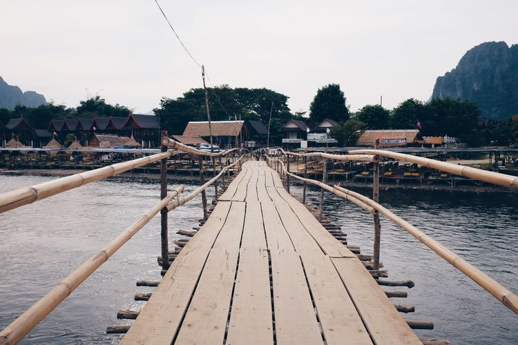 Wooden pier over river in town