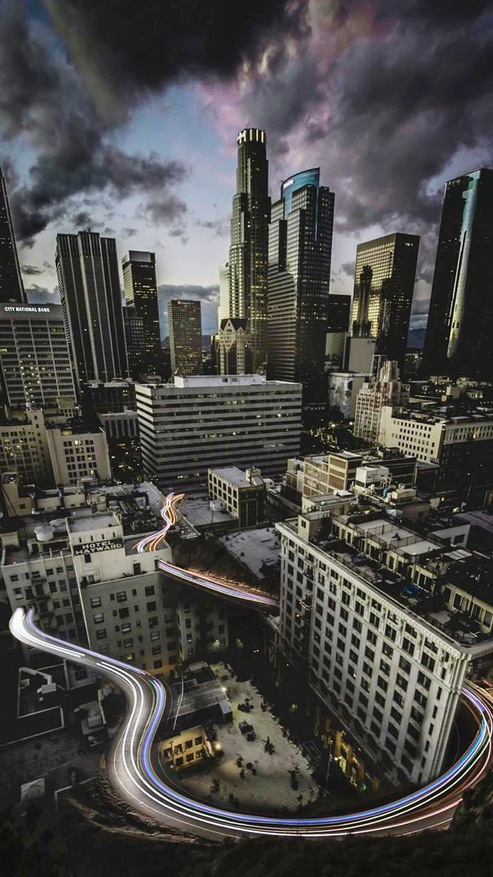 skyscraper, architecture, cityscape, building exterior, city, modern, high angle view, built structure, travel destinations, outdoors, downtown district, tall, cloud - sky, no people, growth, city life, sky, urban skyline, aerial view, day, illuminated