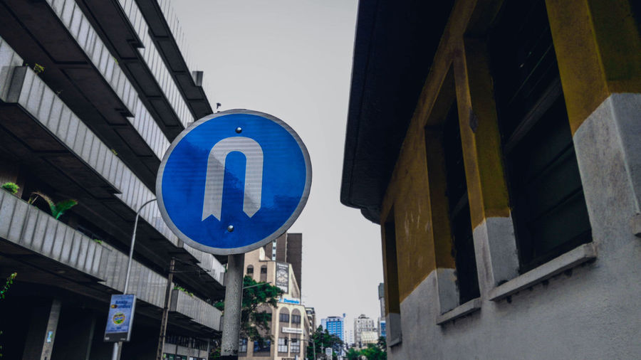Road sign outside buildings in city