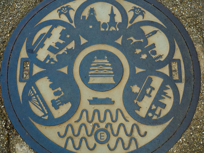 Japan manhole covers Japan Manhole Cover Japan Manhole Covers Circle Close-up Communication Day Design Geometric Shape Manhole Cover Steel Message Metal No People Outdoors Shape Sign Street Text Western Script