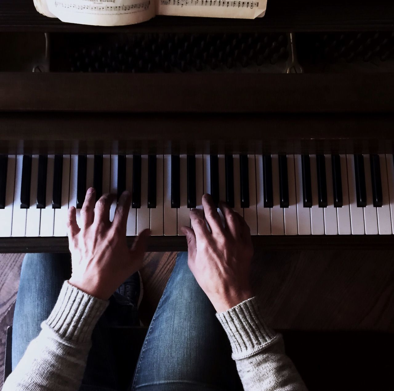 Cropped Image Of Person Hand Playing Piano
