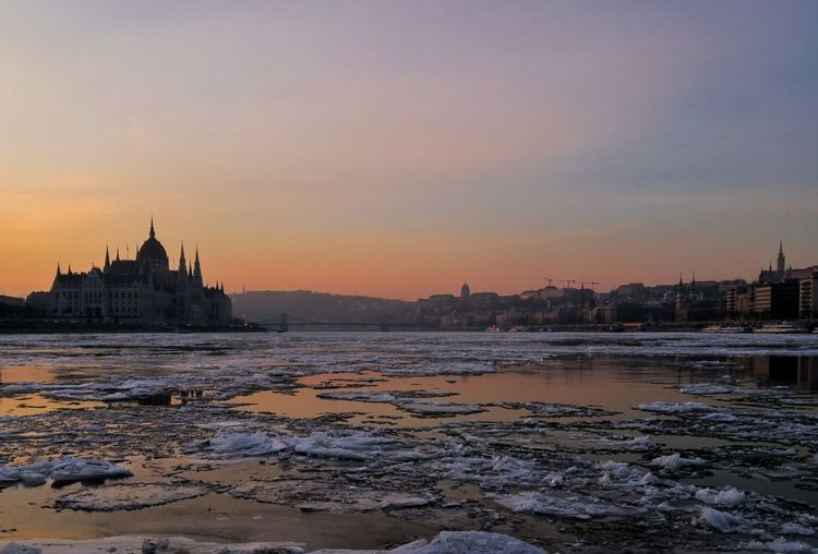 EyeEm Selects Budapest Architecture Water No People Cityscape Outdoors Winter Urban Skyline Sunrise Over Water Icy Morning Icy Danube Danube