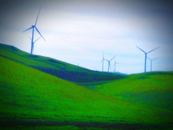 Wind Turbines On A Field Wind Turbines Green Hillside
