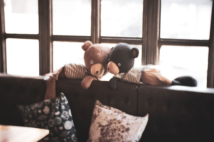 Stuffed Toys On Sofa At Home