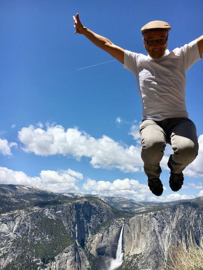 Jump for joy Mountain Waterfall Yosemite Adventure Sky One Person Leisure Activity Nature Limb Human Arm Full Length Real People Sunlight Day Men Jumping Lifestyles Mid-air Casual Clothing Arms Outstretched Motion Low Angle View Enjoyment Outdoors