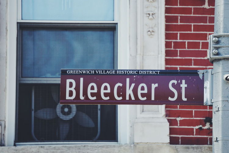 Bleecker Street Bleecker Street NYC Architecture Brick Brick Wall Building Building Exterior Built Structure Communication Day Entrance Glass - Material Greenwich Village Information Information Sign Message No People Outdoors Sign Text Transparent Wall Western Script Window Window Frame