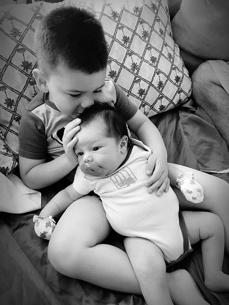 The beauty of brotherly love... Baby Togetherness Innocence Childhood Indoors  Family Bonding Babyhood Love Care Love My Grandbabies Showcase:June Eyeem Market EyeEm Best Shots First Eyeem Photo Best Eyeem Pics B&W Portrait Black And White EyeEm Best Shots - Black + White New Baby Family Innocence Happiness Beginnings
