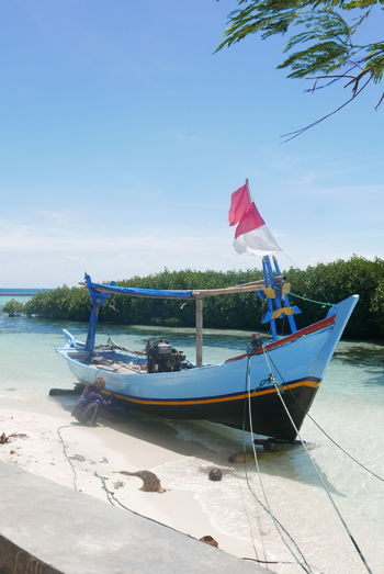 Japan Pramuka Island Thousand Islands Beach Beauty In Nature Boat Day Flag Horizon Over Water Longtail Boat Mode Of Transport Nature Nautical Vessel Outdoors Patriotism Sand Scenics Sea Sky Transportation Water