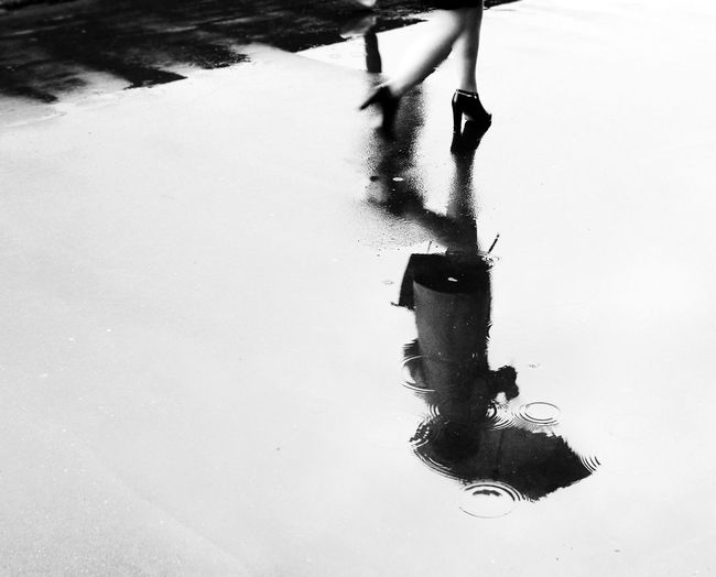 The Street Photographer - 2017 EyeEm Awards Rain Reflection Blackandwhite Blackandwhite Photography Streetphotography Streetphoto_bw Black And White Friday