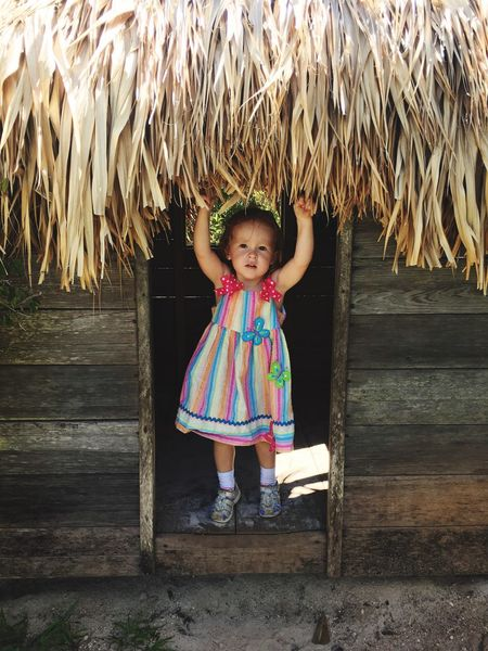 Hut Time Bermuda Aquarium Toddler Life Rainbow Dress Childhood Elementary Age Girls Leisure Activity Leaf Lifestyles Person Casual Clothing Blond Hair Innocence Park - Man Made Space Day Looking At Camera Outdoors Pink Color Palm Leaf Green Color The Portraitist - 2017 EyeEm Awards