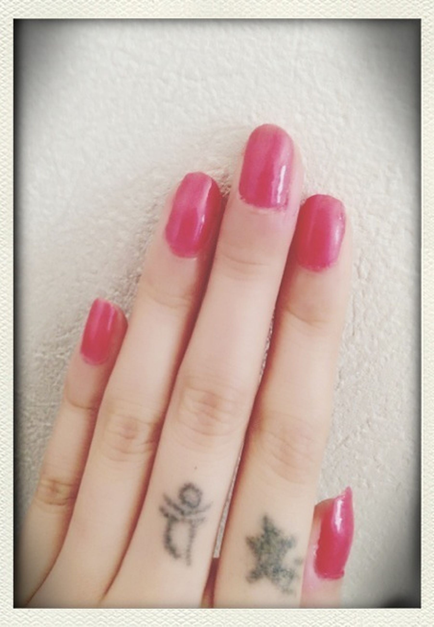 person, indoors, part of, red, transfer print, close-up, human finger, auto post production filter, cropped, pink color, high angle view, nail polish, holding, studio shot, table, multi colored, unrecognizable person